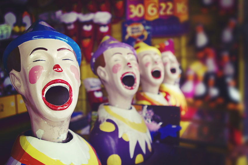 Close up of a laughing clown at the fairground